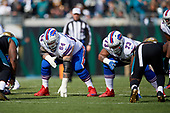 Buffalo Bills guard Richie Incognito (64) and tackle Dion Dawkins (73) on the line during an NFL Wild-Card football game against the Jacksonville Jaguars, Sunday, January 7, 2018, in Jacksonville, Fla.  (Mike Janes Photography)