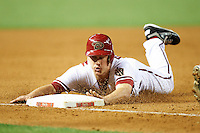 Arizona Diamondbacks pinch runner Tyler Graham #19 slides into third during a National League regular season game against the Colorado Rockies at Chase Field on October 3, 2012 in Phoenix, Arizona. Arizona defeated Colorado 5-3. (Mike Janes/Four Seam Images)