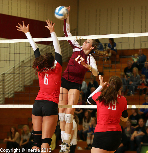 SIOUX FALLS, SD - OCTOBER 25:  Emily Herrera #6 from Rapid City Central try for a double team on Maggie DeJong #17 from Roosevelt in the third game of their match Friday night at Roosevelt. (Photo by Dave Eggen/Inertia)
