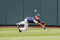 Michigan Wolverines outfielder Jesse Franklin (7) attempts a diving catch against the Florida State Seminoles during the first inning of the NCAA College World Series on June 17, 2019 at TD Ameritrade Park in Omaha, Nebraska. Michigan defeated Florida State 2-0. (Andrew Woolley/Four Seam Images)