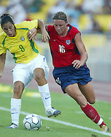 14 August 2004:    Abby Wambach dribbles the ball away from Brazil Defender Daniela at Kaftanzoglio Stadium in Thessaloniki, Greece.   USA defeated Brazil, 2-0. Credit: Michael Pimentel / ISI