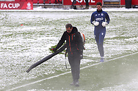 Brentford goalkeeper, Luke Daniels, starts his pre-match warm up as ground staff continue to clear the snow during Brentford vs Leicester City, Emirates FA Cup Football at the Brentford Community Stadium on 24th January 2021