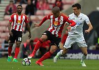 Wahbi Khazri of Sunderland (C) pushes Jack Cork of Swansea City during the Premier League match between Sunderland and Swansea City at the Stadium of Light, Sunderland, England, UK. Saturday 13 May 2017