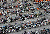 A bicycle park in Tachikawa, Tokyo, Japan. Bicycles are widely used in Japan for everyday life by people of all age groups and social standings. Due to the high popularity of bicycles, there are dedicated bicycle parking areas near most railway stations and shopping centers. .13 Apr 2010