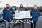 Ger McDonnell presents a cheque for €2,300 to the RNLI in Fenit on Tuesday from his resent swim fundraiser.  L to r: Mike O'Connor, Ger McDonnell and Jackie Murphy (Press Officer RNLI).