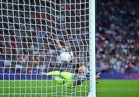 August 09, 2012: Japan's Miho Fukumoto unsuccessfully attempts to save the second goal scored by Cali Lloyd during Women's Football Final match at the Wembley Stadium on day thirteen in Wembley, England. USA defeat Japan 2-1 to win it's third consecutive Olympic gold medal in women's soccer. ..