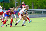 Mannheim, Germany, April 18: During the 1. Bundesliga Damen match between TSV Mannheim (white) and Mannheimer HC (red) on April 18, 2015 at TSV Mannheim in Mannheim, Germany. Final score 1-7 (1-4). (Photo by Dirk Markgraf / www.265-images.com) *** Local caption ***