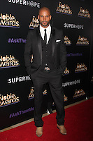 BEVERLY HILLS, CA - FEBRUARY 27: Ricky Whittle at the 3rd Annual Noble Awards at the  Beverly Hilton Hotel in Beverly Hills, California on February 27, 2015. Credit: David Edwards/DailyCeleb/MediaPunch