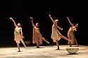 "London, UK. 20.02.20. The Barbican presents Viviana Durante Company, in the world premiere of ""Isadora Now"", an evening paying tribute to feminist icon, Isadora Duncan, in the Barbican theatre. The piece shown is: UNDA, choreographed by Joy Alpuerto Ritter. The dancers are: Begona Cao, Christina Cecchini, Viviana Durante, Nikita Goile, Charmene Pang, Joy Alpuerto Ritter, Serena Zaccagnini.  Photograph © Jane Hobson."