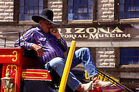 cowboy on red horse carriage. A tough looking cowboy on top of his reed horse wagon in Tombstone foto, reise, photograph, image, images, photo,<br /> photos, photography, picture, pictures, urlaub, viaje, vacation, imagen, viagi, stock