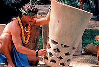 Hawaiian man with pahu ( drum ) at Makahiki festival, Waimea Valley, Oahu