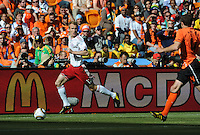 Danish midfielder Thomas Kahlenberg dribbles the right flank in Denmark's opening match of play in World Cup Group E. Holland defeated Denmark, 2-0, June 14th, at Soccer City in the opening match of Group E of the 2010 FIFA World Cup.