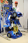 """November 21, 2017, Tokyo, Japan - Japanese robot creator Kenji Ishida of Brave Robotics displays the transformable robot """"J-deite Quarter"""" which can change its shape of a robot to a vehicle at the """"Softbank Robot World 2017"""" in Tokyo on Tuesday, November 21, 2017. Softbank's subsidiary Asratec and Brave Robotics have plan to launch a 4m tall transformable human ride robot """"J-deite RIDE"""".     (Photo by Yoshio Tsunoda/AFLO) LWX -ytd-"""
