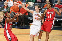 Dec. 6, 2010; Charlottesville, VA, USA; /v50 reaches for the rebound with Radford Highlanders guard/forward Brooke McElroy (20) and Radford Highlanders guard Denay Wood (11) at the John Paul Jones Arena. Virginia won 76-52. Mandatory Credit: Andrew Shurtleff