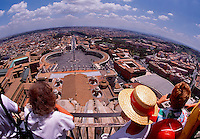 Tourists viewing city from the Cupola of St Peters Basilica Rome Italy