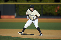 Bobby Seymour (3) of the Wake Forest Demon Deacons takes his lead off of first base against the Gardner-Webb Runnin' Bulldogs at David F. Couch Ballpark on February 18, 2018 in  Winston-Salem, North Carolina. The Demon Deacons defeated the Runnin' Bulldogs 8-4 in game one of a double-header.  (Brian Westerholt/Four Seam Images)