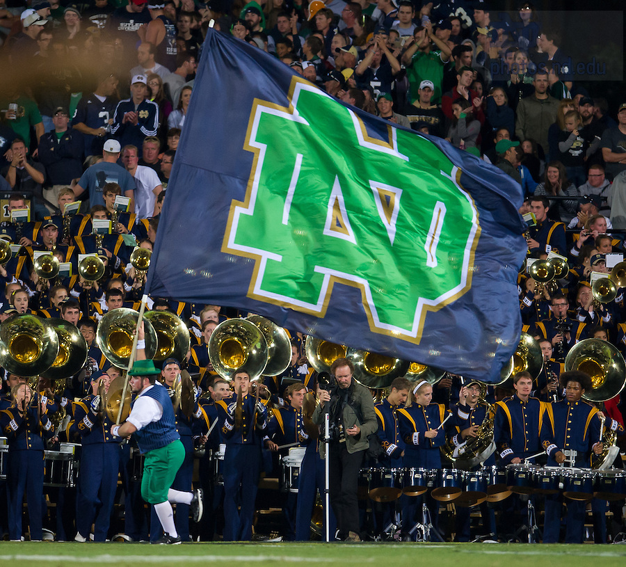 Sept. 14, 2013; The Leprechaun runs with the ND flag after an Irish score against Purdue.<br /> <br /> Photo by Matt Cashore