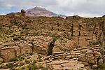 Sandstone rock formations and volcano, Abra Granada, Andes, northwestern Argentina