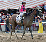 Wonder Gadot returns from the race as Catholic Boy (no. 11) wins the Travers Stakes (Grade 1), Aug. 25, 2018 at the Saratoga Race Course, Saratoga Springs, NY.  Ridden by  Javier Castellano, and trained by Jonathan Thomas, Catholic Boy finished 4 lengths in front of Mendelssohn (No. 8).  (Bruce Dudek/Eclipse Sportswire)