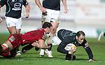 Aaron Shingler tackles George Naoupu..RaboDirect Pro12.Scarlets v Connacht.02.03.12.©STEVE POPE