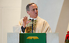 Jan. 22, 2014; University President Rev. John Jenkins, C.S.C. gives the homily during Mass at St. Agnes Church in Arlington, Virginia before the 2013 March for Life. Photo by Barbara Johnston/University of Notre Dame