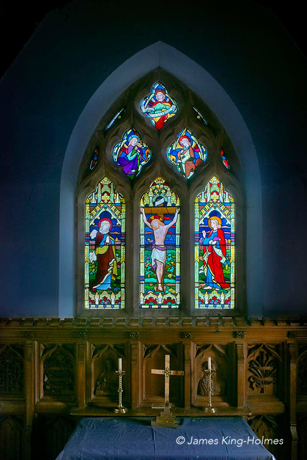 Stained glass window above the altar of St Lawrence Church, Tubney, Oxfordshire, UK. This is the only Protestant church designed by Augustus Pugin. The interior fittings and windows were designed by him and remain unchanged since its consecration in 1847.