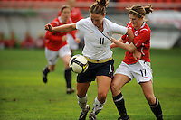 USA forward Lauren Cheney fends off a Norwegian defender.  The USA defeated Norway 2-1 at Olhao Stadium on February 26, 2010 at the Algarve Cup.