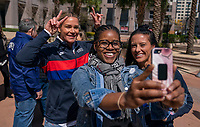 ORLANDO, FL - FEBRUARY 28: Ali Krieger #11 and Ashlyn Harris #18 of the United States take a selfie with a fan at City Hall on February 28, 2020 in Orlando, Florida.