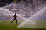 A player of Islamic Republic Iran takes part in a drill as the sprinklers spray water prior to the AFC Asian Cup UAE 2019 Group D match between Vietnam (VIE) and I.R. Iran (IRN) at Al Nahyan Stadium on 12 January 2019 in Abu Dhabi, United Arab Emirates. Photo by Marcio Rodrigo Machado / Power Sport Images