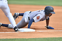 Bowling Green Hot Rods Greg Jones (2) dives back into first base during a game against the Asheville Tourists on May 29, 2021 at McCormick Field in Asheville, NC. (Tony Farlow/Four Seam Images)