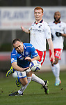St Johnstone v Ross County...15.03.14    SPFL<br /> Lee Croft is sent flying by Scott Boyd<br /> Picture by Graeme Hart.<br /> Copyright Perthshire Picture Agency<br /> Tel: 01738 623350  Mobile: 07990 594431