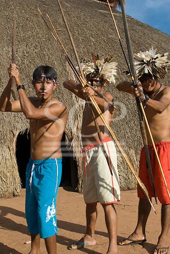 Xingu Indigenous Park, Mato Grosso State, Brazil. Aldeia Moygu (Ikpeng). Resian Kawire Ikpeng, Tawarero Ikpeng and Payata Ikpeng, angry at the construction of dams affecting indigenous territories.