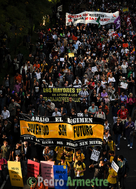 """People hold placards and banners reading """"We don not owe, we don not pay"""" as they take part in a demonstration against government's austerity reforms and the public payment of bank's debts on October 13, 2012 in Madrid. © Pedro ARMESTRE"""