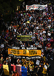 "People hold placards and banners reading ""We don not owe, we don not pay"" as they take part in a demonstration against government's austerity reforms and the public payment of bank's debts on October 13, 2012 in Madrid. © Pedro ARMESTRE"