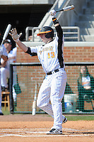 Matt Duffy #13 of the Tennessee Volunteers follows through on his swing at Lindsey Nelson Stadium against the the Manhattan Jaspers on March 12, 2011 in Knoxville, Tennessee.  Tennessee won the first game of the double header 11-5.  Photo by Tony Farlow / Four Seam Images..