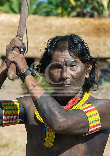 Pará State, Brazil. Aldeia Moikarako. Warrior Kremrotuk Kayapo is armed with a 'borduna' traditional club.