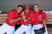 TEMPE - MARCH 10:  Kendry Morales (right), coach Dino Ebel, and Juan Rivera of the Los Angeles Angels of Anaheim hang out in the dugout before a spring training game against the Cincinnati Reds on March 10, 2010 at Tempe Diablo Stadium in Tempe, Arizona. (Photo by Brad Mangin)