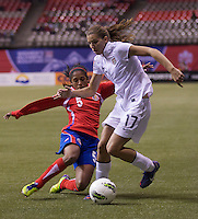 Tobin Heath, left, of the United States tries to get past Diana Saenz of Costa Rica during play in the CONCACAF Olympic Qualifying semifinal match at BC Place in Vancouver, B.C., Canada Friday Jan. 27, 2012. The United States won the match 3-0 to earn a berth in 2012 London Olympics.