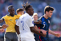 DENVER, CO - JUNE 3: Alberth Elis #7 of Honduras Gio Reyna #7 of the United States during a game between Honduras and USMNT at EMPOWER FIELD AT MILE HIGH on June 3, 2021 in Denver, Colorado.