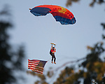 July 1, 2017- Arthur, IL- A skydiver prepares to land with an American flag as the National Anthem is being performed prior to the 2017 Arthur Fireworks celebration. [Photo: Douglas Cottle]