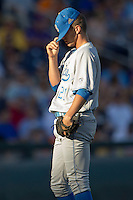 UCLA pitcher Nick Vander Tuig (21) has a quiet moment before the game against the North Carolina State Wolfpack in the 2013 Men's College World Series on June 18, 2013 at TD Ameritrade Park in Omaha, Nebraska. The Bruins defeated the Wolfpack 2-1, eliminating North Carolina State from the tournament. (Andrew Woolley/Four Seam Images)