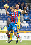 Inverness Caley Thistle v St Johnstone…27.08.16..  Tulloch Stadium  SPFL<br />Steven Anderson clears from Alex Fisher<br />Picture by Graeme Hart.<br />Copyright Perthshire Picture Agency<br />Tel: 01738 623350  Mobile: 07990 594431