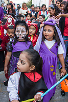"Oaxaca, Mexico, North America.  Day of the Dead Celebrations.  Childrens' Parade, Procession, ""Comparsa"", in Memory of the Dead.  Costumes."