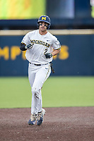 Michigan Wolverines outfielder Jonathan Engelmann (2) jogs around the bases after hitting a home run against the Maryland Terrapins on April 13, 2018 in a Big Ten NCAA baseball game at Ray Fisher Stadium in Ann Arbor, Michigan. Michigan defeated Maryland 10-4. (Andrew Woolley/Four Seam Images)