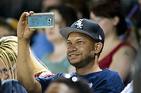 A fan uses his smart phone to record video during the Carolina League game between the Salem Red Sox and the Winston-Salem Dash at BB&T Ballpark on June 16, 2016 in Winston-Salem, North Carolina.  The Dash defeated the Red Sox 7-1.  (Brian Westerholt/Four Seam Images)