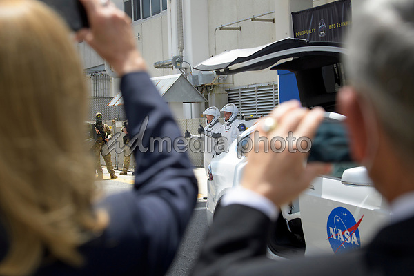 In this photo released by the National Aeronautics and Space Administration (NASA), NASA astronauts Douglas Hurley, left, and Robert Behnken, wearing SpaceX spacesuits, are seen as they depart the Neil A. Armstrong Operations and Checkout Building for Launch Complex 39A to board the SpaceX Crew Dragon spacecraft for the Demo-2 mission launch, Saturday, May 30, 2020, at NASA's Kennedy Space Center in Florida. NASA's SpaceX Demo-2 mission is the first launch with astronauts of the SpaceX Crew Dragon spacecraft and Falcon 9 rocket to the International Space Station as part of the agency's Commercial Crew Program. The test flight serves as an end-to-end demonstration of SpaceX's crew transportation system. Behnken and Hurley are scheduled to launch at 3:22 p.m. EDT on Friday, May 30, from Launch Complex 39A at the Kennedy Space Center. A new era of human spaceflight is set to begin as American astronauts once again launch on an American rocket from American soil to low-Earth orbit for the first time since the conclusion of the Space Shuttle Program in 2011. <br /> Mandatory Credit: Bill Ingalls / NASA via CNP/AdMedia