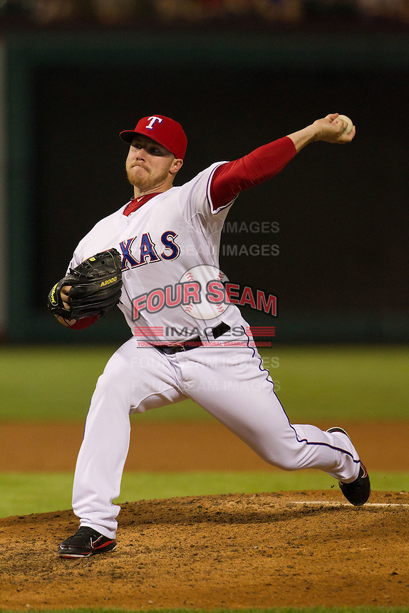 Texas Rangers pitcher Robbie Ross # 28 delivers during the Major League Baseball game against the Baltimore Orioles on August 21st, 2012 at the Rangers Ballpark in Arlington, Texas. The Orioles defeated the Rangers 5-3. (Andrew Woolley/Four Seam Images).
