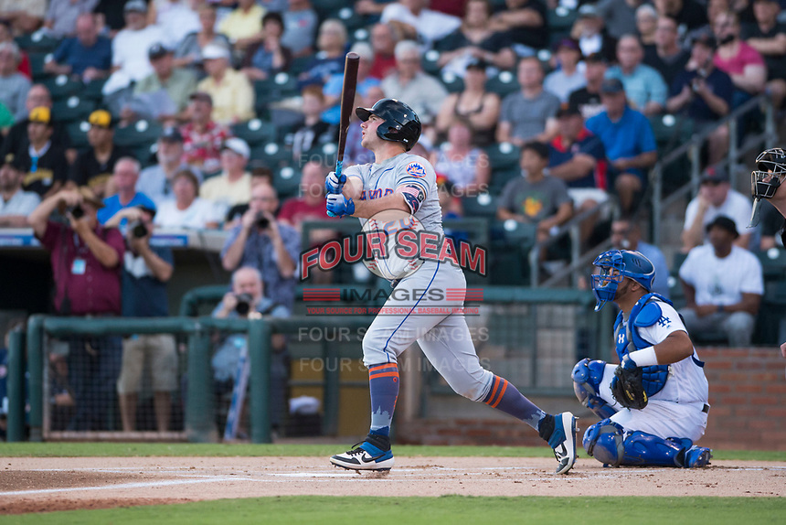 AFL East first baseman Peter Alonso (20), of the Scottsdale Scorpions and the New York Mets organization, hits a home run in front of catcher Keibert Ruiz (17) and home plate umpire Adam Beck in the top of the first inning during the Fall Stars game at Surprise Stadium on November 3, 2018 in Surprise, Arizona. The AFL West defeated the AFL East 7-6 . (Zachary Lucy/Four Seam Images)