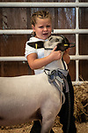 Quinn Ferguson tearful with her lamb during the 56th Junior Livestock Auction, Back in the Saddle Again, Sunday at the 82nd Amador County Fair, Plymouth, California<br /> .<br /> .<br /> .<br /> @AmadorCountyFair, #1SmallCountyFair, #VisitAmador, #PlymouthCalifornia, #AmadorCountyFair, #Best4DaysOfSummer, #AmadorCounty, #26thDAA