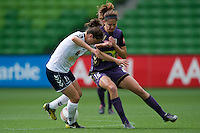 MELBOURNE, AUSTRALIA - DECEMBER 18: Kate GILL of the Glory and Kendall FLETCHER of the Victory compete for the ball during the round 7 W-League match between the Melbourne Victory and the Perth Glory at AAMI Park on December 18, 2010 in Melbourne, Australia. (Photo Sydney Low / asteriskimages.com)